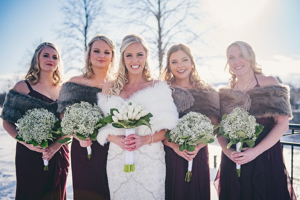 Bride and her bridal party in mill race park