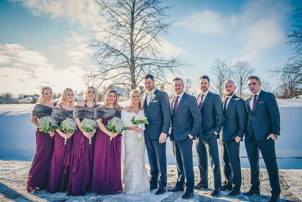 wedding party photo in mill race park in winter time