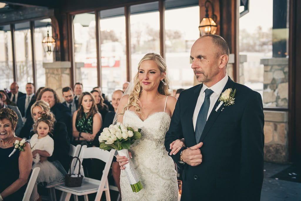 Bride walking down the aisle with her father for her wedding at the Cambridge Mill