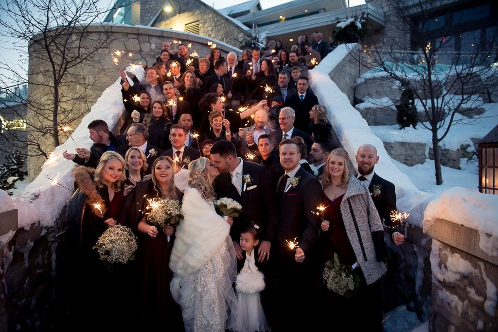 sparkler photo of whole wedding on the front steps at the Cambridge Mill.