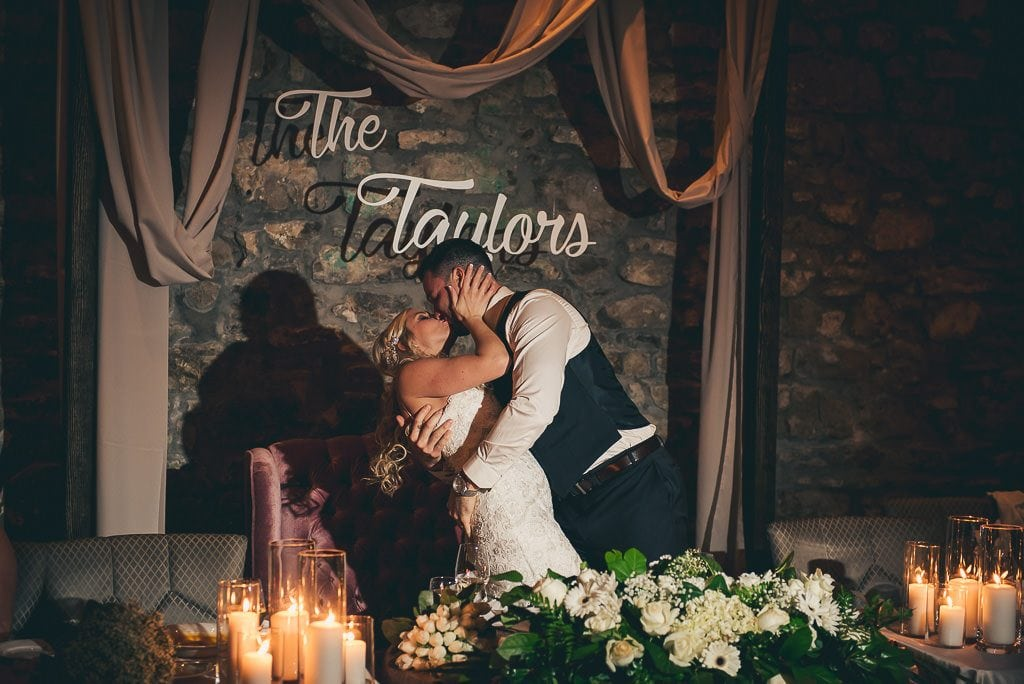bride and groom kissing at their wedding reception at the Cambridge Mill