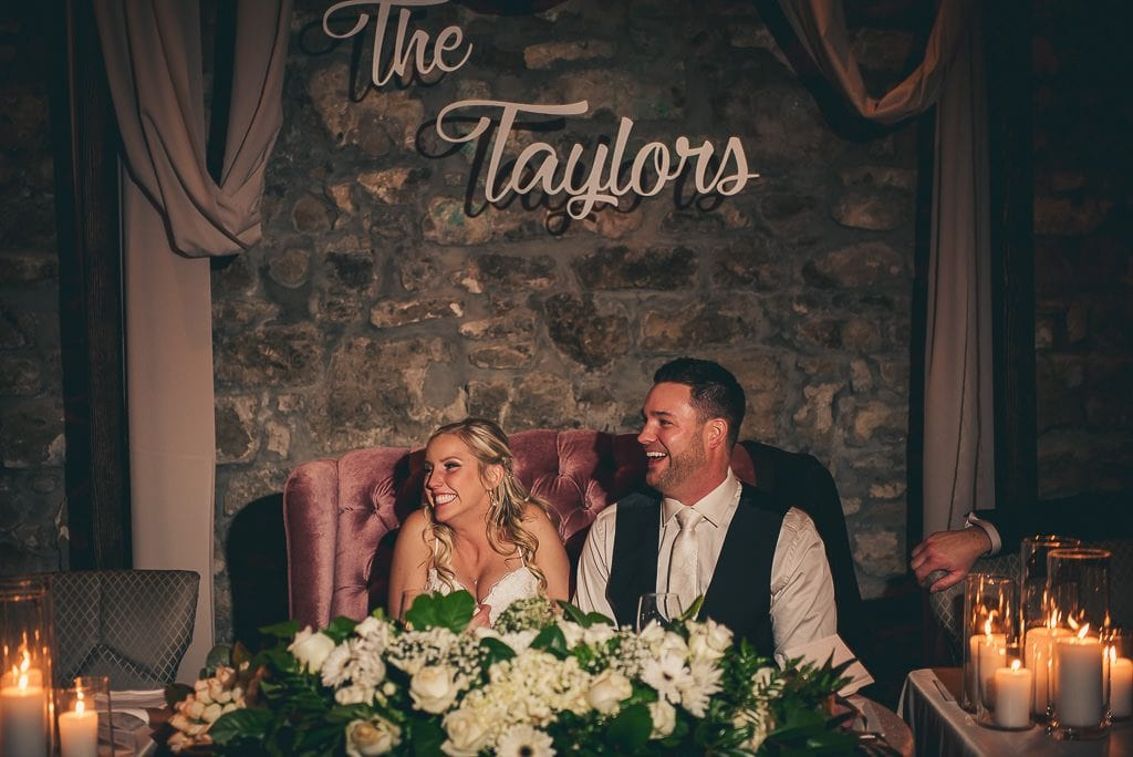 bride and groom laughing during speeches at the Cambridge Mill