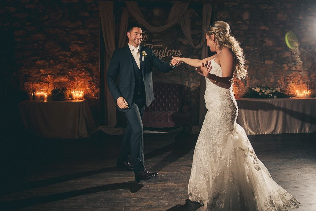 bride and groom dancing fist dance at the Cambridge Mill