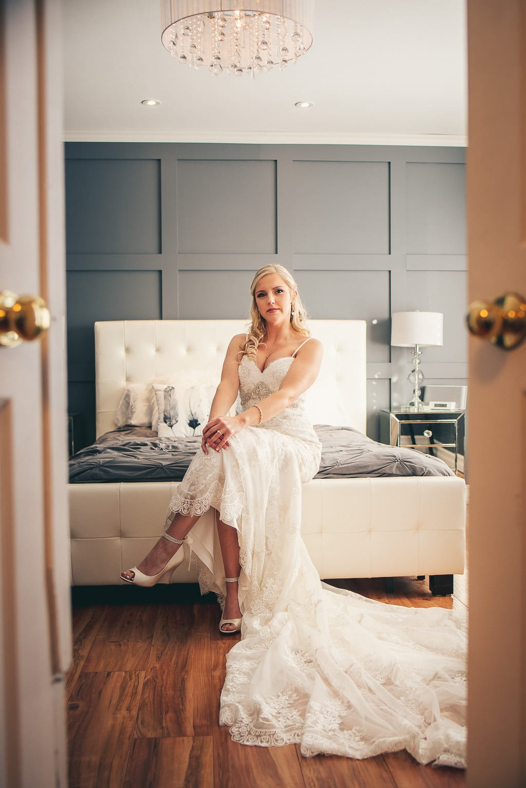 Bridal portrait, bride sitting on her bed