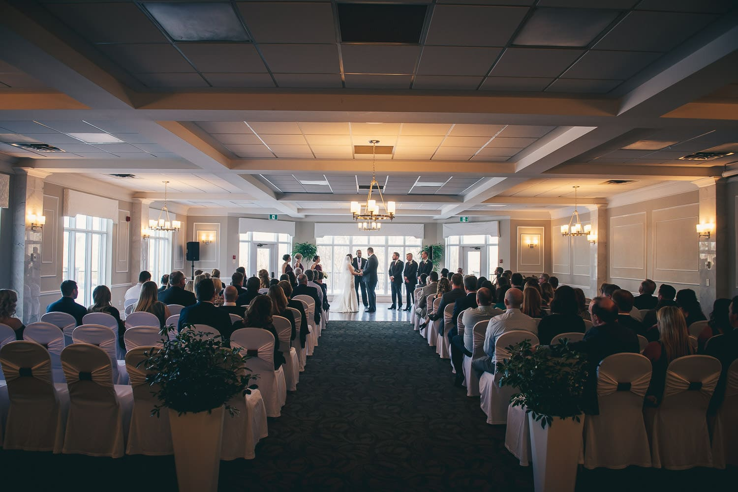 wedding ceremony in the grand ballroom at the Elmhurst Inn