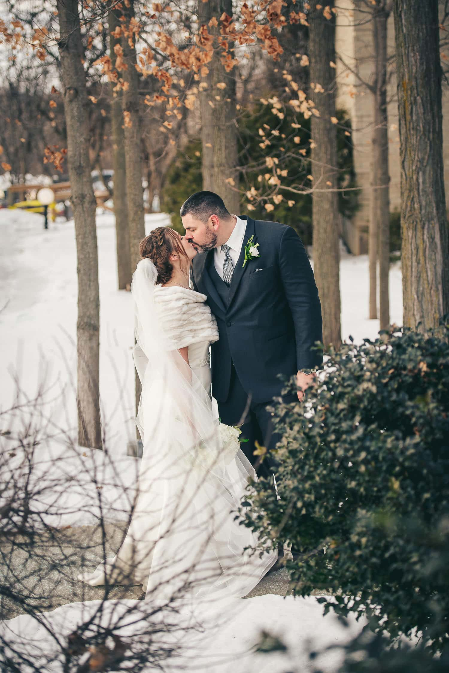 bride and groom kissing for wedding photo at Elmhurst Inn