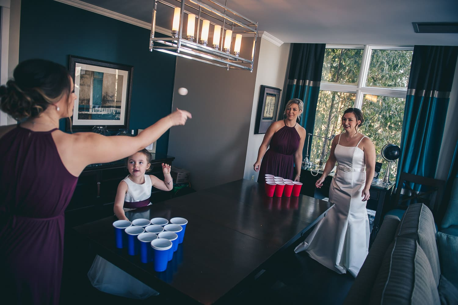 bridesmaids playing beer pong at the Elmhurst Inn before wedding