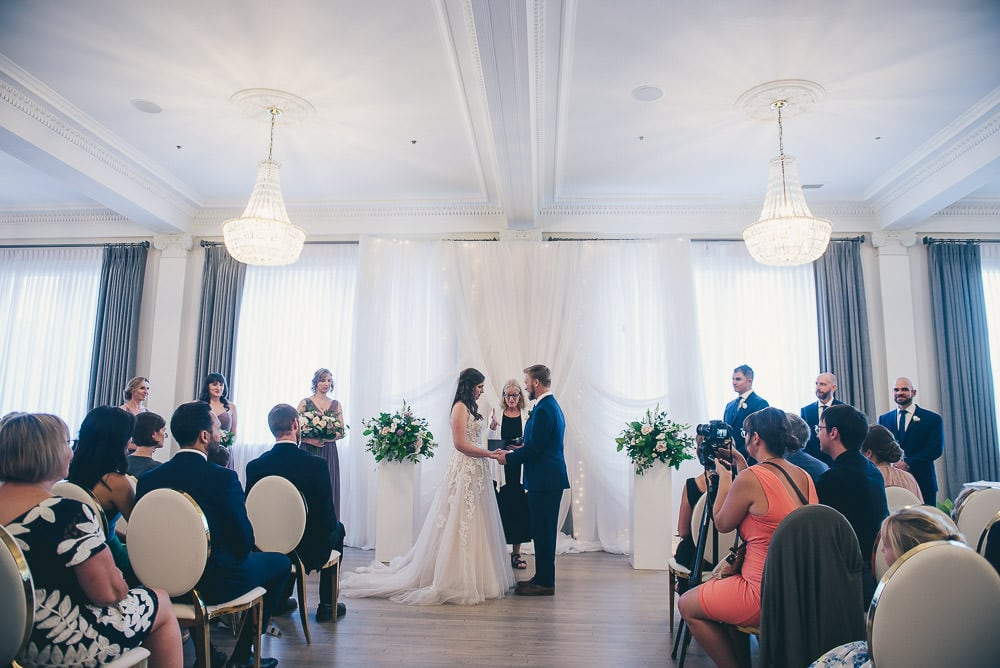 wedding ceremony in crystal ballroom for walper hotel wedding